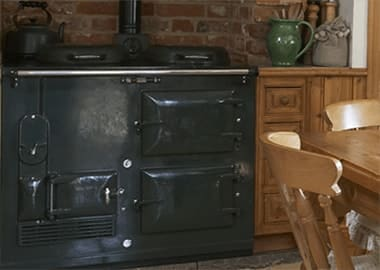 a black classic two oven Aga in a old fashioned kitchen